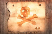 Old paper with jolly roger — Stock Photo