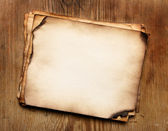 Papers on wood table — Stock Photo