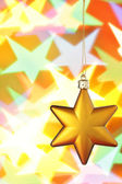 Gold Christmas star — Stock Photo