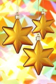 Three gold Christmas stars — Stock Photo