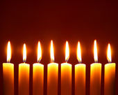 Eight alight candles — Stock Photo