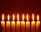 Eight alight candles — Stock Photo