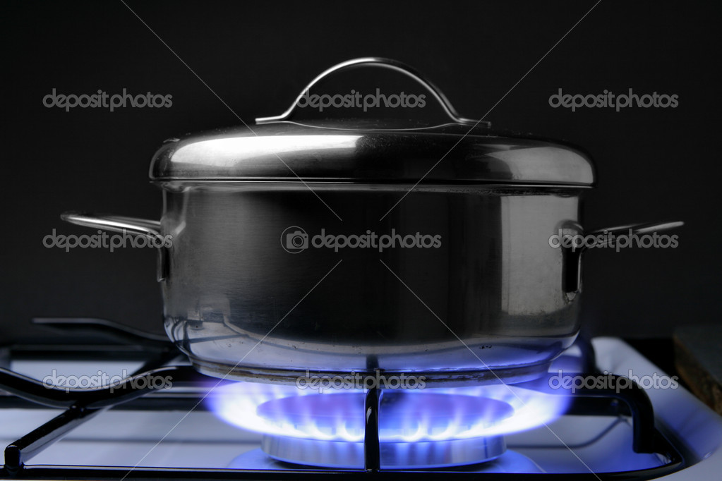 Crock on the gas stove over black background — Stock Photo #1424837