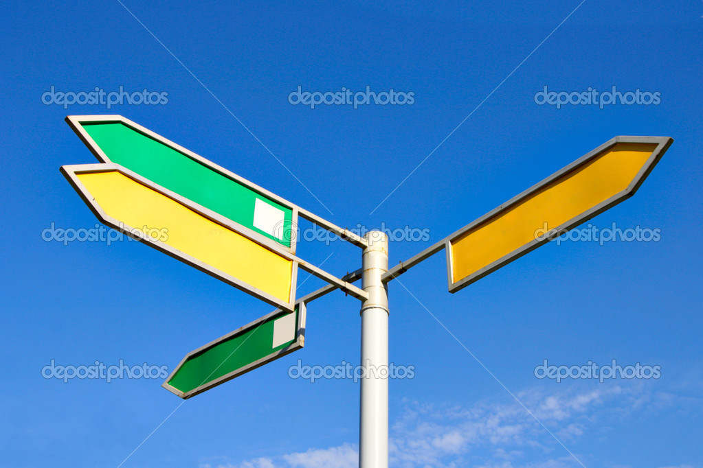 Signpost with four direction arrow with blank space for your own text against a blue sky — Stock Photo #1424895