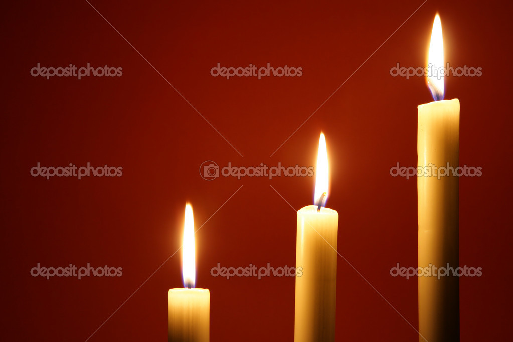 Three burning candles over red background — Stock Photo #1425869