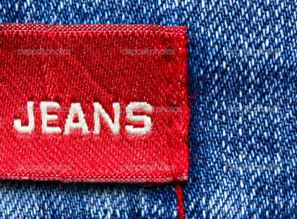 Blue jeans and red label with word Jeans — Stock Photo #1427609