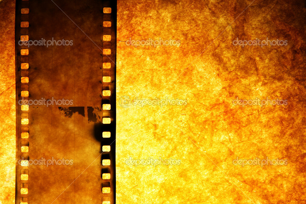 Old film strip over grunge paper background — Stock Photo #1427664