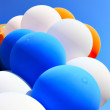 Colorful balloons against blue sky — Stock Photo