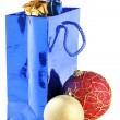 Gift bag and christmas balls — Stock Photo