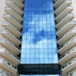Modern building with sky reflection — Stock Photo