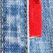 Blue jeans with red label — Stock Photo #1431596