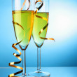 Champagne with gold streamer — Stock Photo
