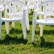 Stock Photo: Armchair on green lawn