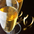 Glasses of champagne and gold streamer — Stock Photo