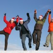 Friends with Santa hats dancing — Stock Photo