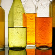Colorful bottles with alcohol — Stock Photo