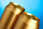 Golden beer cans — Stock Photo
