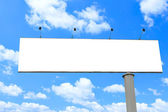 Blank long billboard over blue sky — Stock Photo
