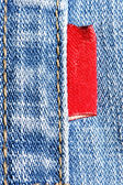 Blue jeans with red label — Stock Photo