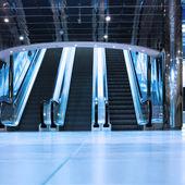 Escalators. Modern interior of trade center. — Stock Photo
