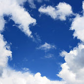 Blue sky and frame from clouds — Stock Photo