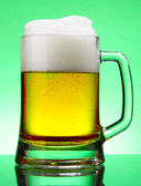 Mug of beer with froth — Stock Photo