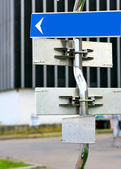 Signpost with direction arrows — Stock Photo