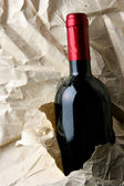 Red wine and crumpled paper — Stock Photo
