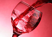 Close-up of pouring red wine — Stock Photo