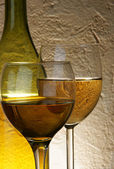 Glasses of white wine and bottle — Stock Photo