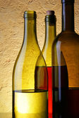 Three wine bottles — Stock Photo