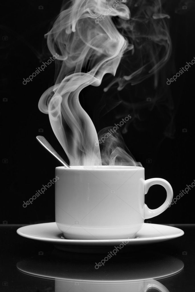 Cup of hot drink with steam over black background — Stock Photo #1431699