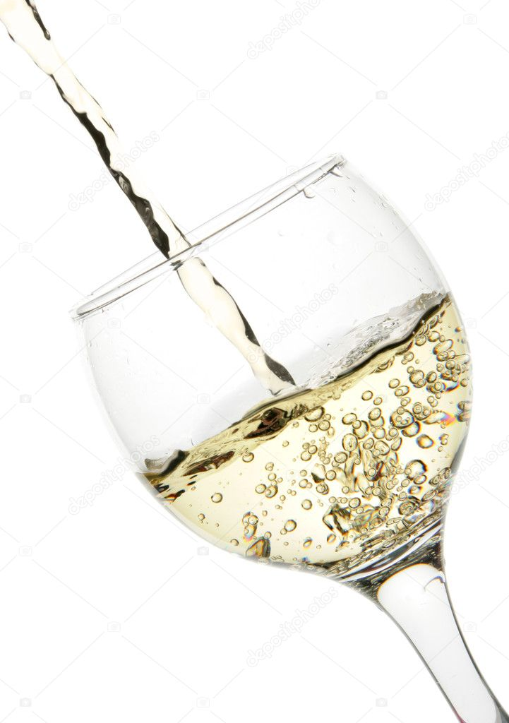 White wine pour into glass close-up isolated over white background — Stock Photo #1435680