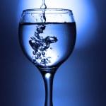 Liquid pour into glass — Stock Photo