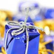 Blue gift box close-up - Stock Photo