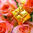 Expensive gift and roses — Stock Photo