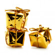 Stock Photo: Golden gift boxes