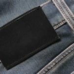 jeans con etiqueta en blanco negro — Foto de Stock