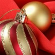 Christmas balls over red background — 图库照片