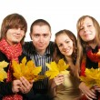 Stock Photo: Friends with maple leaves