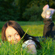 Stock Photo: Woman lie on grass