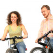 Pretty woman and young man on a bicycles isolated over a white background — Stock Photo #1446147