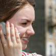 Smiling teen girl with cell phone — Stock Photo