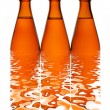 Three beer bottles in a row — Stock Photo