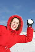 Woman playing snowball fight — Stock Photo