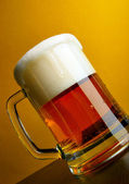 Beer mug close-up with froth — Stock Photo