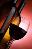 Bottles and glass of red wine — Stock Photo