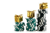 Casino chips with golden boxes — Stock Photo