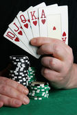 Hand with royal flush — Stock Photo