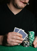 Hands of card-player — Stock Photo